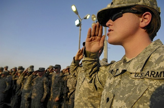 "U.S. Army Spc. Amanda Vasquez, with Headquarters and Headquarters Troop, 3rd Heavy Brigade Combat Team, 1st Cavalry Division, renders a salute during the presentation of the colors at ""Fight Night for Heroes,"" the first ever mixed martial arts fights held in Iraq, at Forward Operating Base Marez, in Mosul, Iraq, Sept. 5. The event, sponsored by Xtreme Couture G.I. Foundation, featured mostly active duty military members with 17 fights on the card and over 1,000 Soldiers, Sailors, Airmen, Marines and civilians in attendance."